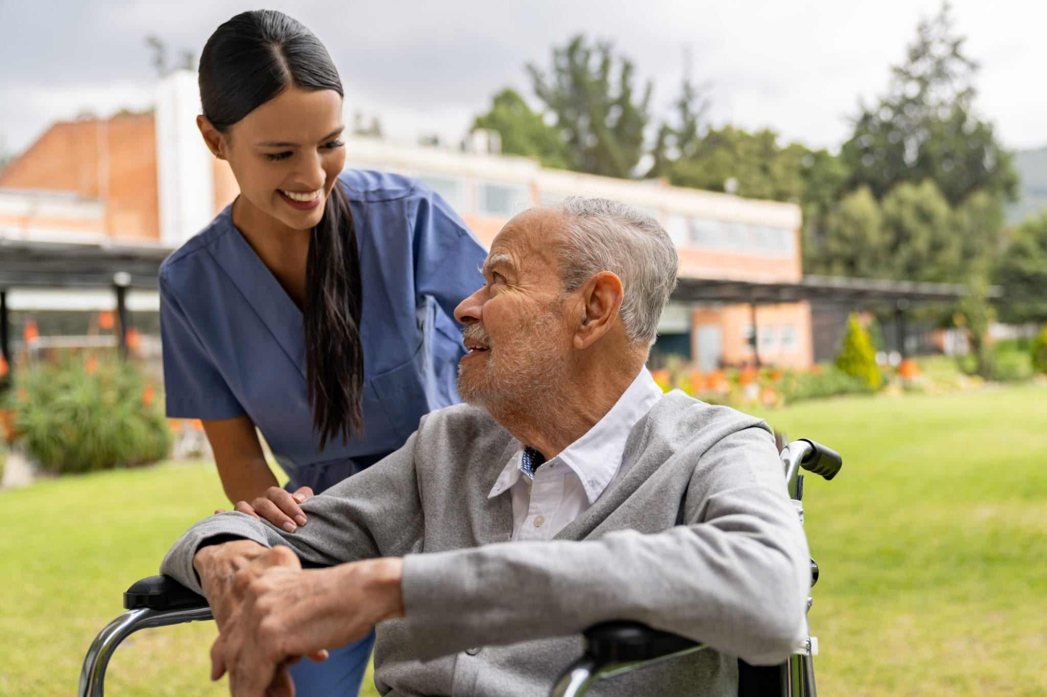 Hospice nurse with senior patient outdoors